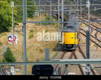 Dutch koploper-type intercity train near station Breda, the Netherlands - Stock Photo