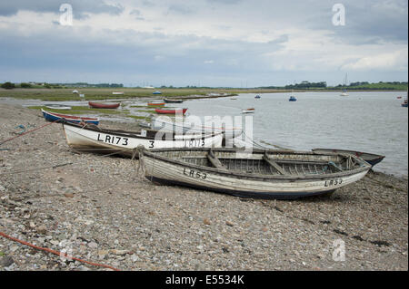 View of boats on shoreline at coastal village, only community on U.K. mainland dependent upon tidal access, with - Stock Photo
