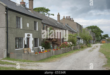 Houses in coastal village, only community on U.K. mainland dependent upon tidal access, with vehicular access to - Stock Photo