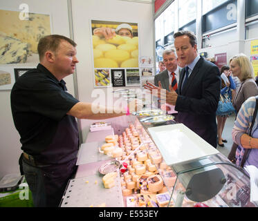 Llanelwedd, Builth Wells, Powys, Wales, UK . 21st July, 2014. Royal Welsh Show, Llanelwedd. Prime Minister David Cameron visits the Caws Cenarth stand at the Food Hall.