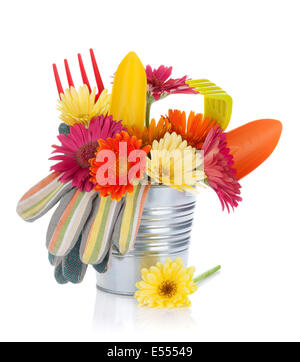 Colorful flowers and garden tools. Isolated on white background - Stock Photo