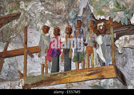 Tau Tau ancestral figures of the Toraja people in rock tomb, Rantepao, Tana Toraja, Sulawesi, Indonesia - Stock Photo