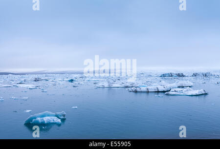 Floating ice in the turquoise water of the Jokulsarlon Glacier Lagoon, Iceland - Stock Photo