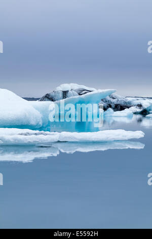 Iceberg  and floating ice in the turquoise water of the Jokulsarlon Glacier Lagoon, Iceland - Stock Photo