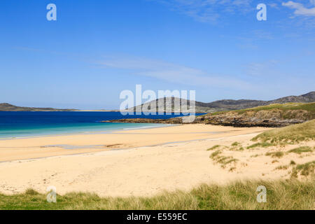 View across pristine sands of Traigh Lar beach to Isle of Taransay on west coast Horgabost Isle of Harris Outer - Stock Photo
