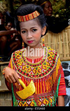 Toraja girl in traditional dress, Rantepao, Tana Toraja, Sulawesi, Indonesia - Stock Photo