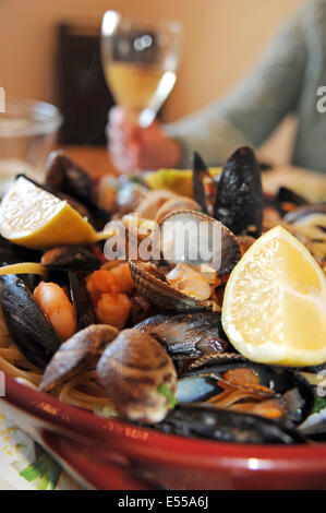 Seafood of mussels clams prawns and cockles with linguine pasta - Stock Photo