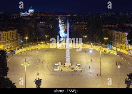 Piazza del Popolo at night with St Peter's basilica in the distance in Rome, Italy - Stock Photo
