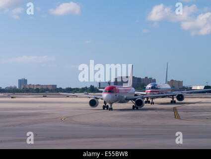 Commercial passenger plane taxiing at airport - Stock Photo