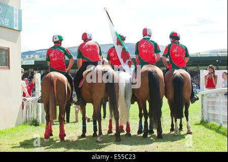 Llanelwedd, UK. 21st July 2014. Team Wales make their way to the Main Ring for The Royal Welsh Mounted Games. A - Stock Photo
