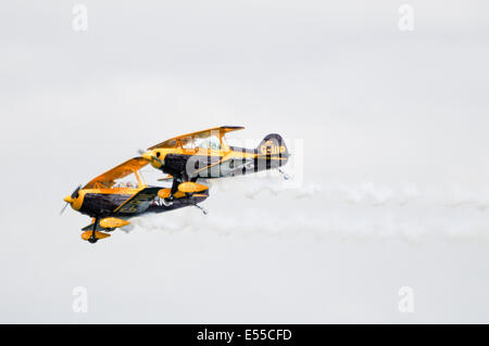 Two Pitts S-1D Special Private (G-PIII and G-IIIP) fly in close formation - Stock Photo