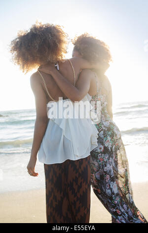 Two African-American female friends enjoying time in Venice Beach, California. - Stock Photo