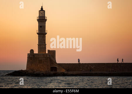 Chania lighthouse and harbor at sunset, Crete, Greece - Stock Photo