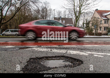 Road with potholes, inner city road, - Stock Photo
