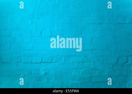 Blue painted brick wall - Stock Photo