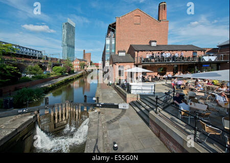 The Castlefield historic inner city canal area including Dukes 92 and lock and Beetham Tower (background) in Manchester - Stock Photo