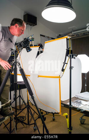 Commercial photography set including lighting background and grip photographer working on a commercial photography set including lighting background and grip gear aloadofball Images