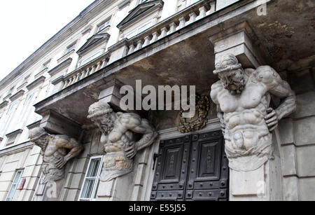 Corbel and Atlas on a building in the Old Town of Warsaw - Stock Photo