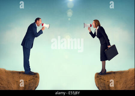 business concept conflict megaphone businessman and businesswoman - Stock Photo