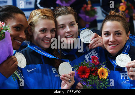 Kazan, Russia. 21st July, 2014. France's national fencing team members Saoussen Boudiaf, Brunet Manon, Cecilia Berder, - Stock Photo