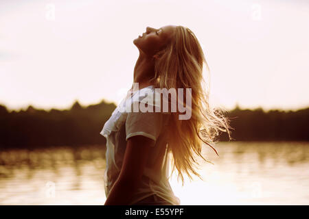 Portrait of a young woman in backlight - Stock Photo