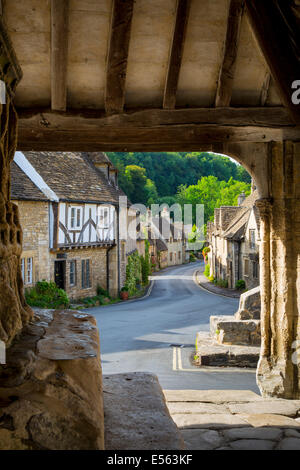Early Morning view through the Market Cross Monument in Castle Combe, Cotswolds, Wiltshire, England - Stock Photo