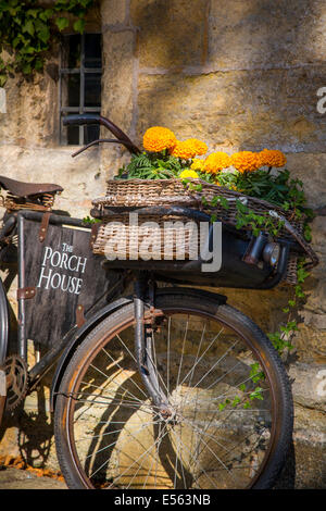 Bicycle parked outside The Porch House Pub and Inn, Stow-on-the-Wold, Gloucestershire, England - Stock Photo