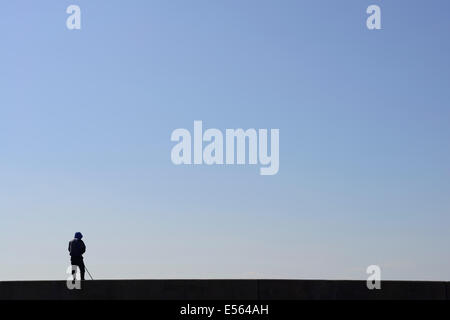 Fisherman on Gunkajima (Hashima), Nagasaki Prefecture, Kyushu, Japan - Stock Photo