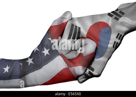 Diplomatic handshake between countries: flags of United States and South Korea overprinted the two hands - Stock Photo