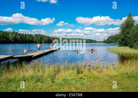 Summer in Sweden - people enjoying a sunny day by a lake - Stock Photo