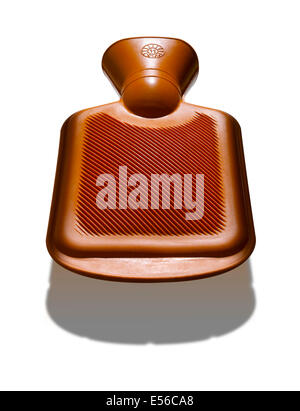 A an orange hot water bottle with strong shadow below - Stock Photo