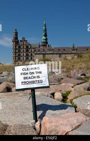 Sign on the beach at Kronborg, Elsinore, Denmark, a very popular fishing point for anglers. Castle Kronborg in the - Stock Photo