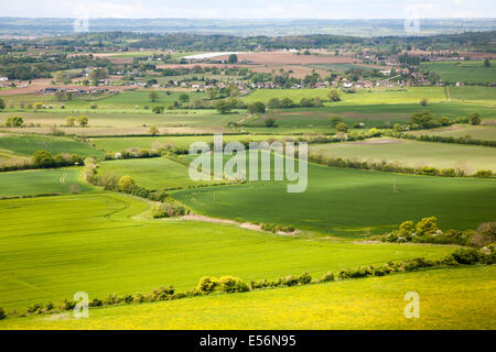 Summer view over patchwork of green fields looking east distant Cotswolds, Roundway Hill, near Devizes, Wiltshire, - Stock Photo