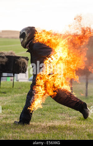 Stunt man on fire at Scott May's Daredevil stunt show, Matterley Bowl, Winchester, Hampshire, England. - Stock Photo