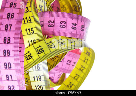 Measuring tapes isolated over a white background - Stock Photo