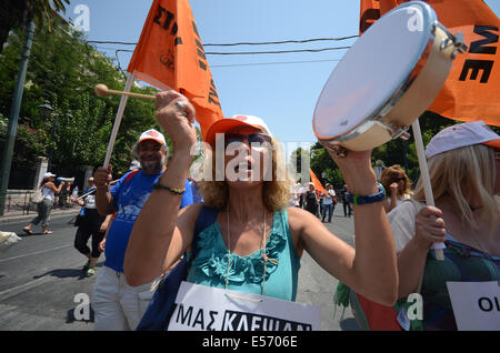 Athens, Greece. 22nd July, 2014. A demonstrator uses a small drum to make noise during the demonstration. Greek - Stock Photo