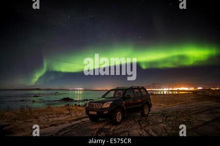 Aurora Borealis or Northern lights, Kjalarnes, Reykjavik, Iceland - Stock Photo