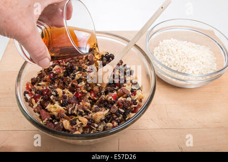 making traditional mincemeat  adding brandy to the mincemeat with suet in the background spoon ready to stir (4 - Stock Photo