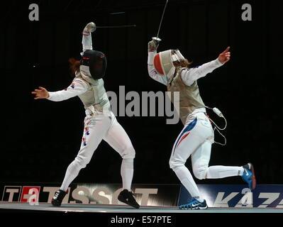 Kazan, Russia. 21st July, 2014. South Korea's Mina Kim (L) and France's Corinne Maitrejean in the women's team foil - Stock Photo