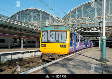 A Northern Rail Class 142 Pacer at the platform of Manchester Piccadilly Rail Station. - Stock Photo