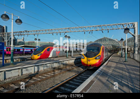 Two Virgin Class 390 Pendolino trains in the platforms of Manchester Piccadilly Rail Station. - Stock Photo