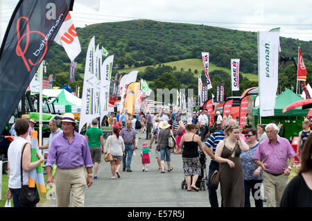 Crowd passing through tractor machinery stands at the Royal Welsh Show 2014 - Stock Photo