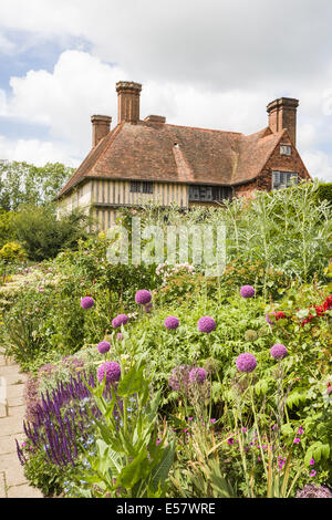 House and long border at Great Dixter, Northiam, East Sussex, architect Edwin Lutyens, home of famous gardener Christopher - Stock Photo