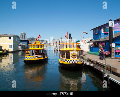 Two Victoria H2O Water Taxis and tourists at Fisherman's Wharf in Victoria, British Columbia, Canada. - Stock Photo