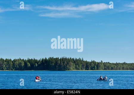 Two canoes with canoeists on Lake Asnen, Smaland, Sweden - Stock Photo