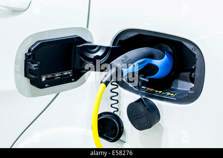 Charging with a 230-volt charger, gun, electric car Mercedes-Benz B-Class electric drive, 65th International Motor - Stock Photo