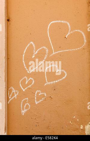 Hearts, painted with chalk on a house wall, Ljubljana, Slovenia - Stock Photo