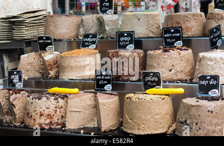 Halva, a sweet dense sesame confection for sale at Machane Yehuda market, Jerusalem, Israel - Stock Photo