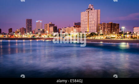 Just before dawn on Durban beach front - Stock Photo