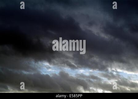 Grey rain clouds against blue sky - Europe Germany Berlin - Stock Photo